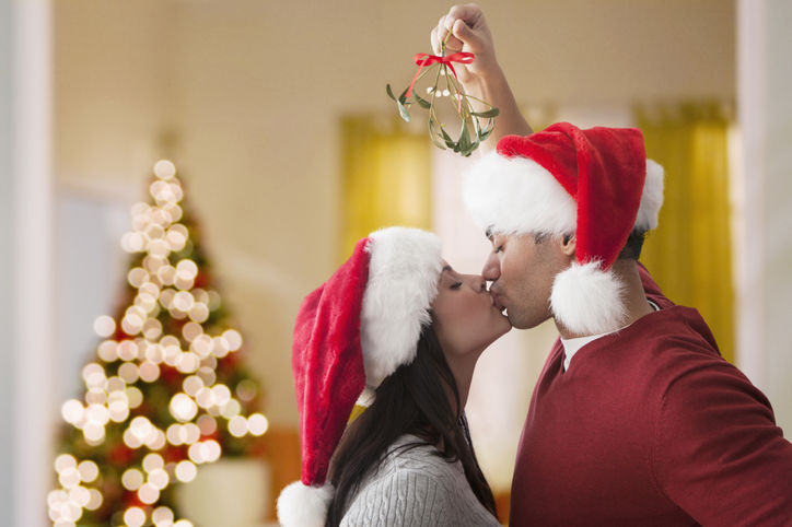 Couple Kissing Under The Mistletoe