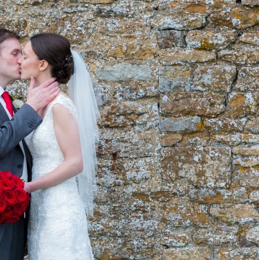 Photo of Bride and Groom kissing