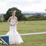 Bride playing tennis