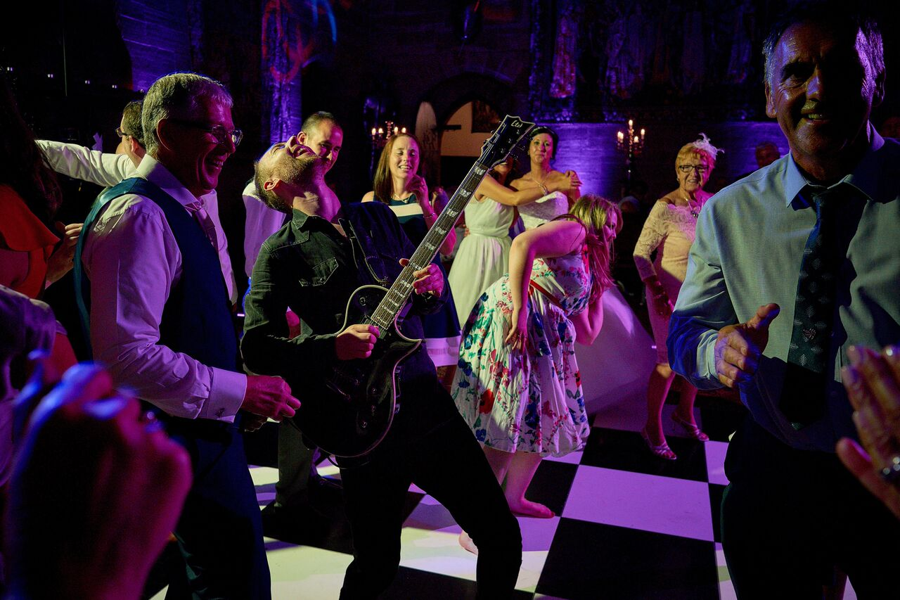 Supercharged Wedding Band on the Dance Floor with guests dancing