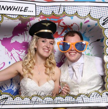 Real Wedding Blog Photobooth Bride and Groom