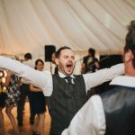 Groom Dancing Wedding Reception