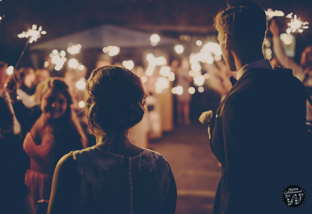 couple looking out at their wedding guests