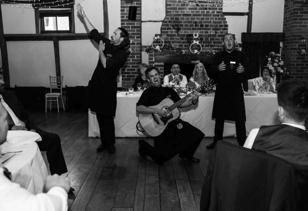 Singing waiters in black and white