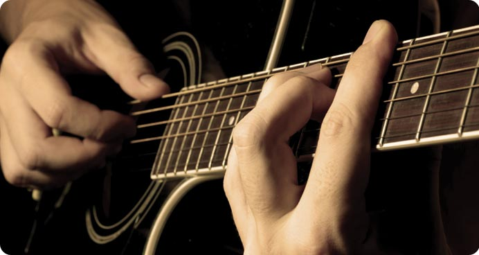 Hire a classical or Spanish guitarist to provide a wide range of background